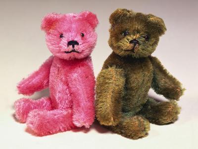 A Pink Schuco Scent Bottle Teddy Bearand a Green Schuco Compact Teddy Bear,