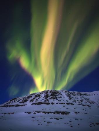 Aurora Borealis over Toviktinden Mountain in Troms County, Norway