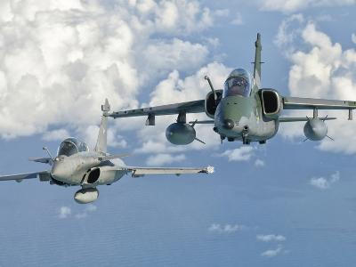 A Dassault Rafale of the French Air Force Flys Alongside an Embraer A-1B of the Brazilian Air Force