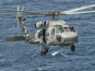 A US Navy SH-60F Seahawk Flying Off the Coast of Pakistan