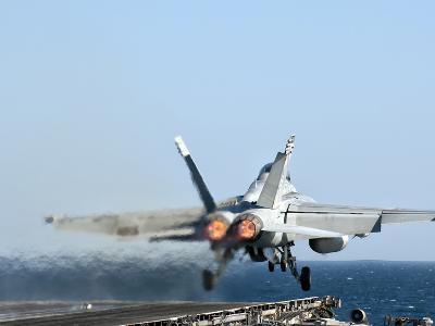 An F/A-18F Super Hornet Launches from the Flight Deck of Aircraft Carrier USS Nimitz