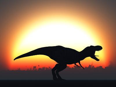 A T. Rex Silhouetted Against the Setting Sun at the End of a Prehistoric Day