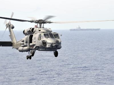 An MH-60R Seahawk Helicopter in Flight over the Pacific Ocean
