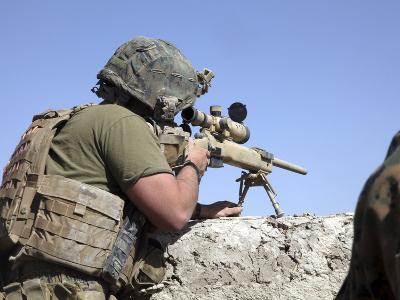 A U.S. Marine Looks Through the Scope of an M40A1 Sniper Rifle