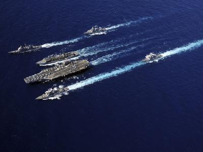 The Abraham Lincoln Carrier Strike Group Ships Cruise in Formation in the Pacific Ocean
