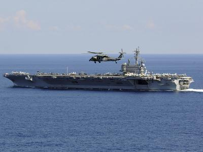 An MH-60S Seahawk Helicopter Flies over USS George H.W. Bush