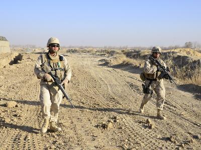 Soldiers Conduct a Perimeter Security Check around a Combat Outpost in Diwar, Afghanistan