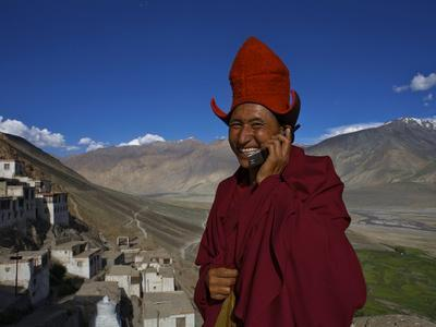 The Head Abbot Holds a Cell Phone at the Karsha Monastery