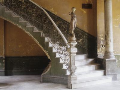 A Circular Marble Staircase and Statue in Central in Central Havana