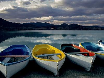 Boats on the Shore of Lake Banyoles at Sunset