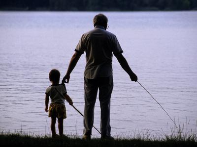 A Man and a Boy Fishing Along the Shore of Lake Banyoles