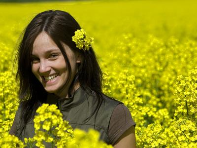 A Young Woman in a Field of Rapeseed, Brassica Napus