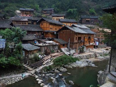 Wooden Houses Line the Duliu River in Xijiang