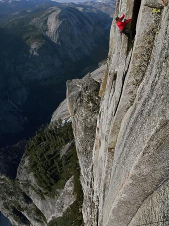 A Climber, Without a Rope, Clings with Fingertips to Half Dome