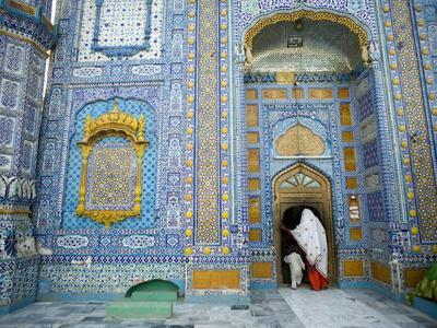 A Woman and Child Entering a Sufi Shrine in Sindh Province, Pakistan