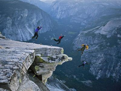 Climbers BASE jump from Half Dome and hike down the back of the mountain.