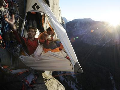 Climbers live in a portaledge when working on a route.