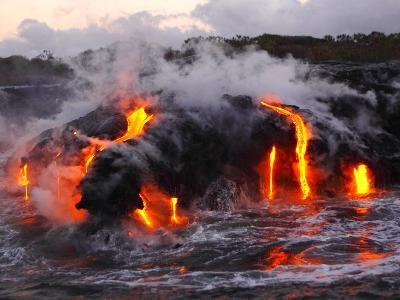 Hot Magma Spills into the Sea from under a Hardened Lava Crust