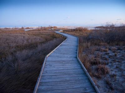 A Wooden Walkway across Marshland Toward the Ocean