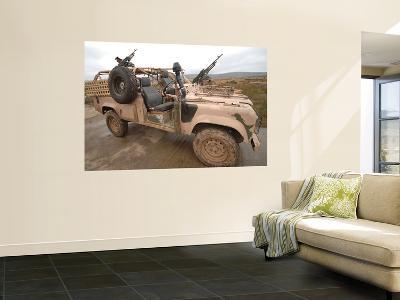 A Pink Panther Land Rover Desert Patrol Vehicle
