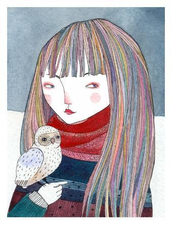 A Girl with a Small Owl Sitting on Her Hand