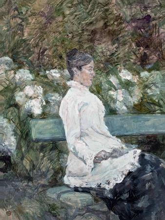 Woman Seated on a Bench in a Park