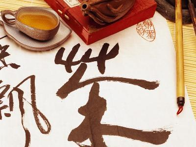 Chinese Calligraphy on Scroll Before Tea Set