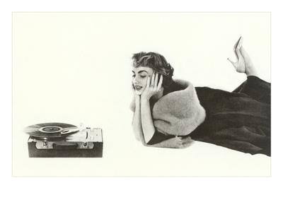 Heavily Browed Lady Listening to Record Player