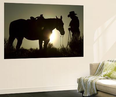 Cowboy With His Horse at Sunset, Ponderosa Ranch, Oregon, USA