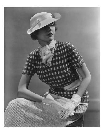Vogue - January 1935 - Woman in Knitted Sportswear and White Hat