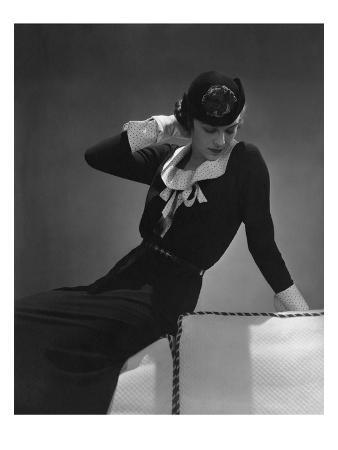 Vogue - January 1935 - Model Sitting on the Back of a Sofa