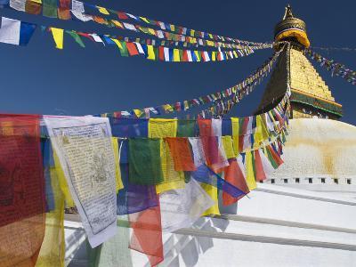 Prayer Flags Flutter from the Apex of Bodnath Stupa, Kathmandu, Nepal