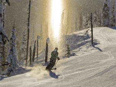 Skiing Through a Sundog on Corduroy Groomed Runs at Whitefish Mountain Resort, Montana, Usa