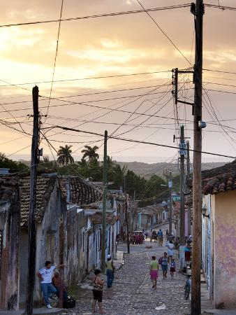 View Along Traditional Cobbled Street at Sunset, Trinidad, Cuba, West Indies, Central America