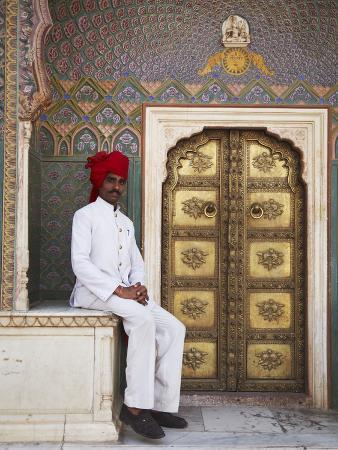 Palace Guard Sitting at Rose Gate in Pitam Niwas Chowk, City Palace, Jaipur, Rajasthan, India, Asia