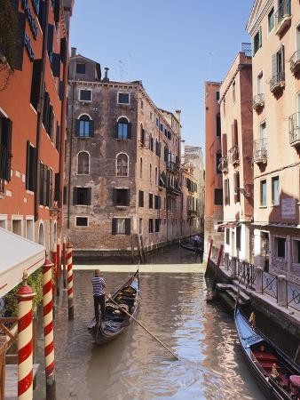 A Gondola on a Canal in Venice, UNESCO World Heritage Site, Veneto, Italy, Europe