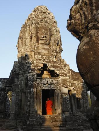 Monk at the Bayon Temple, Angkor Thom Complex, Angkor, UNESCO World Heritage Site, Cambodia