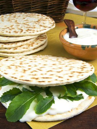 Piadina Flat Bread With Rucola and Stracchino Cheese, Typical Emilia Romagna Food