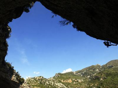 A Climber Tackles an Overhanging Climb in the Mascun Canyon, Rodellar, Aragon, Spain, Europe
