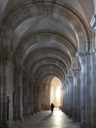 Interior North Nave Aisle with Priest Walking Away, Vezelay Abbey, UNESCO World Heritage Site, Veze