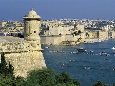View over Bastions and Grand Harbour to Fort St. Angelo with Rowing Regatta, Valletta, Malta, Medit