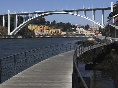 The Arrabida Bridge, Designed by Edgar Cardoso, Spans the River Douro Between Vila Nova De Gaia and