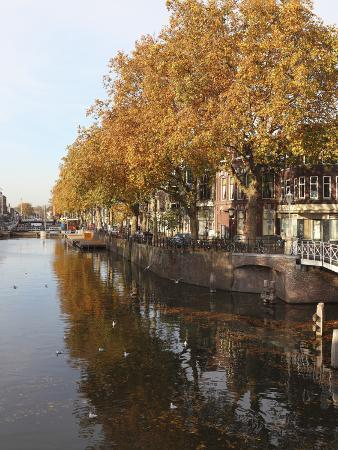 Autumnal Leaves Reflect in the Water of a Canal in Central Utrecht, Utrecht Province, Netherlands,