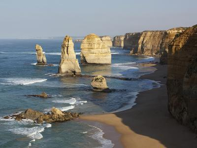 Morning Sun Lights Twelve Apostles, Tasman Sea, Port Campbell National Park, Victoria, Australia