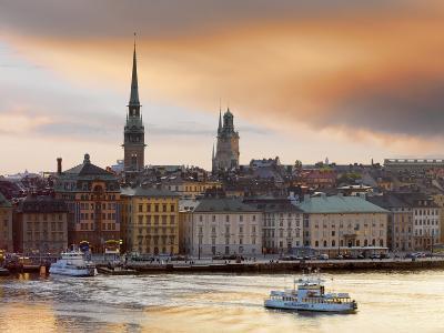 Sweden, Stockholm, Riddarfjarden, Gamla Stan, Passenger Ferries in Bay at Dusk