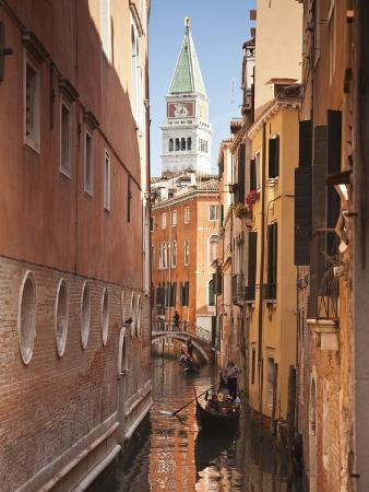 Campanile and Gondola on Canal in Venice, Italy