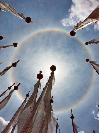 A Very Unusual Full Circle Rainbow Phenomenon Surrounded by Lungdhar Buddhist Prayer Flags