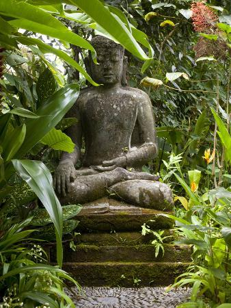 Bali, Ubud, a Statue of buddha Sits Serenely in Gardens