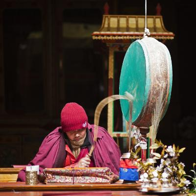 India, Ladakh, Hemis, Monk Reciting Prayers to the Slow Rhythm of a Drum at Hemis Monastery