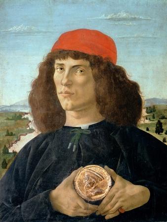 Portrait of a Young Man Holding a Medallion of Cosimo I De' Medici ('The Elder') (1389-1463)